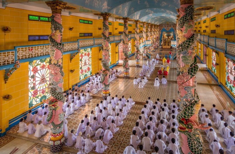 full-church-priest-followers-praying-vietnam-must-do-day-trip-cu-chi-tunnels-and-cao-dai-temple-from-ho-chi-min-city-IMG_7894